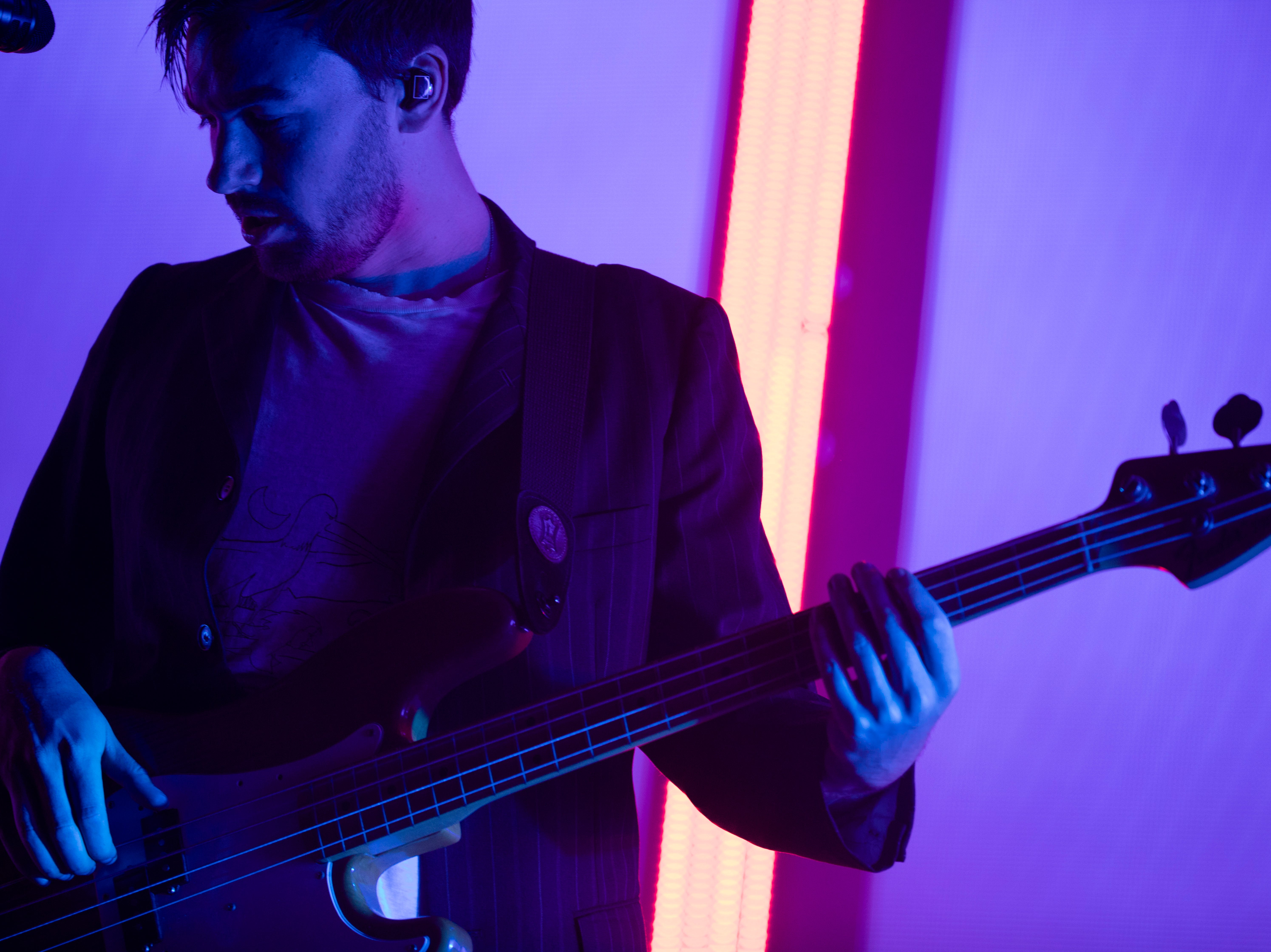 Ross MacDonald, The 1975 bassist, performs during The 1975 concert at the PNC Pavilion on Sunday, May 12, 2019 in Cincinnati.