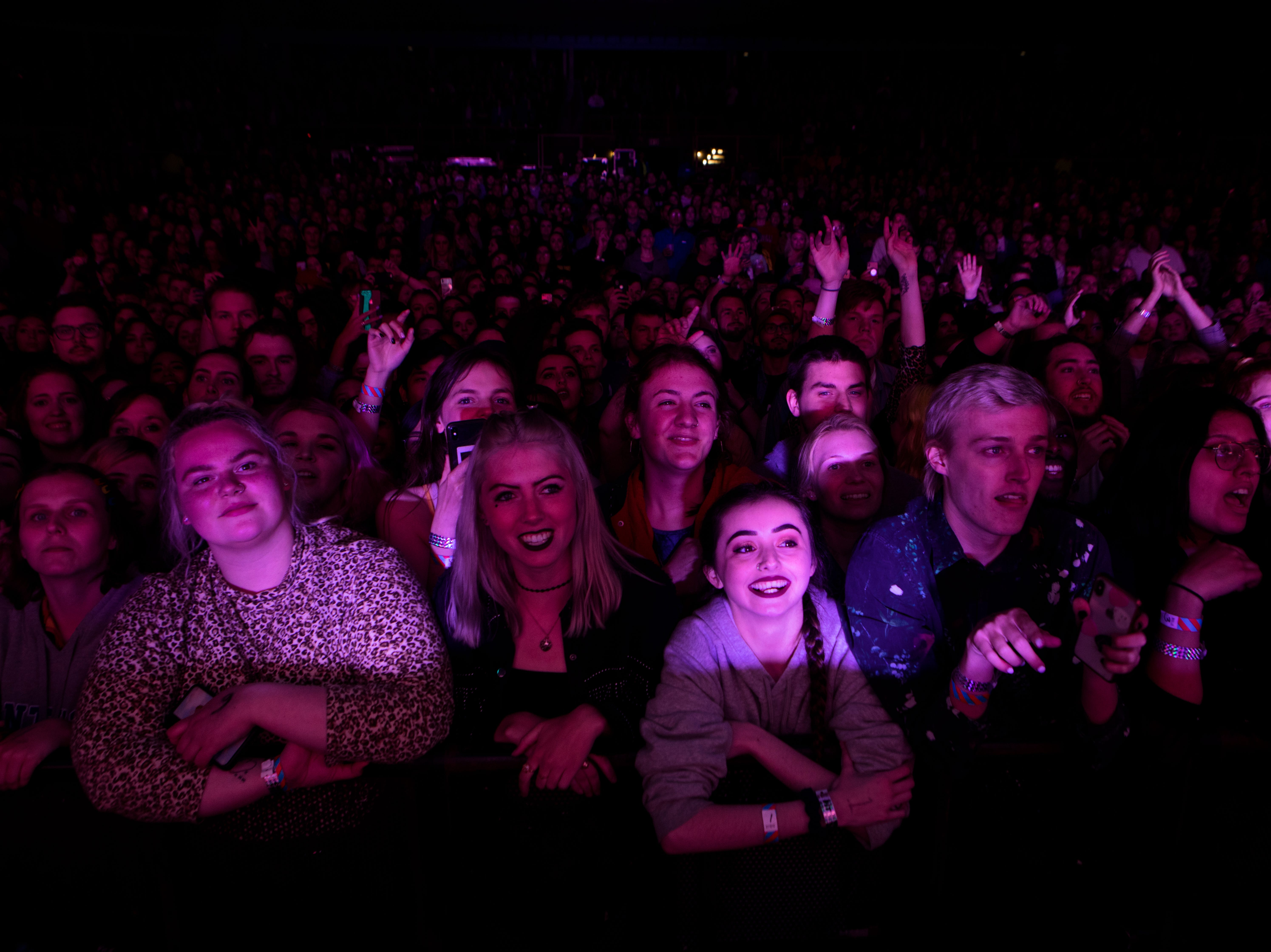 Fans cheer as The 1975 perform at the PNC Pavilion on Sunday, May 12, 2019 in Cincinnati.