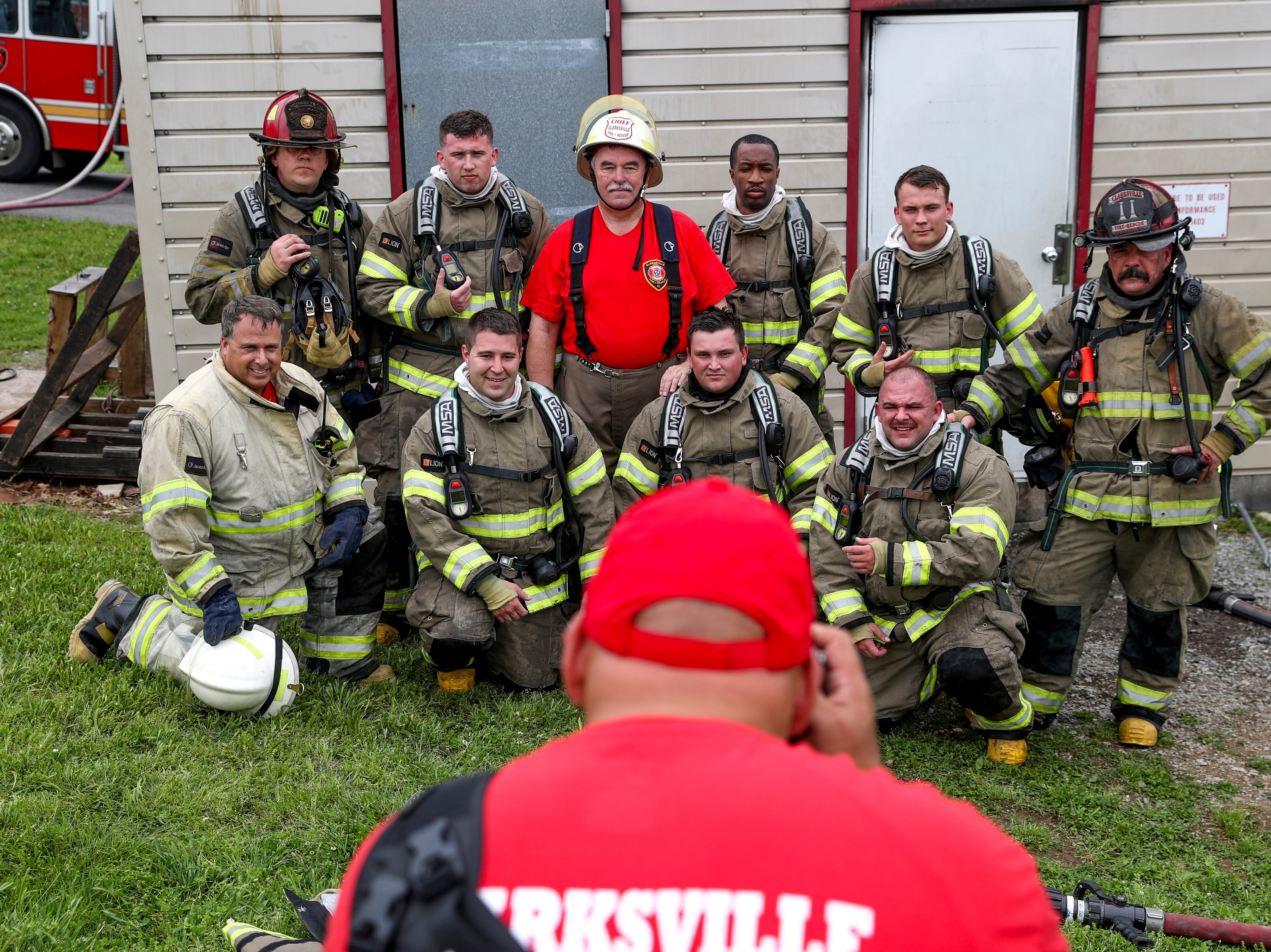 Captain Michael Rios takes a photo of the whole group going through a live fire drill at Clarksville Fire Rescue in Clarksville, Tenn., on Friday, May 10, 2019.