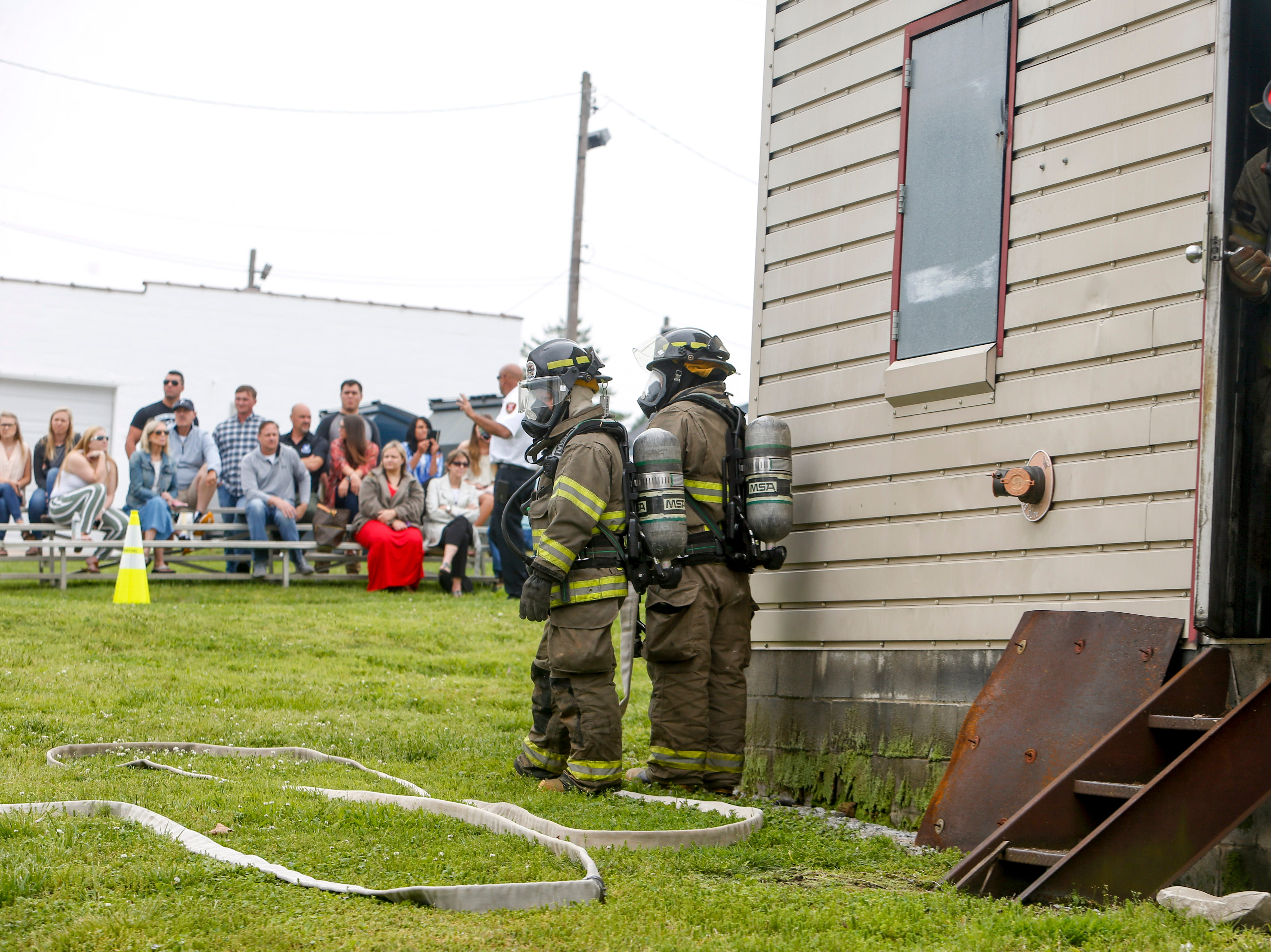 Captain Butch McCurdy looks out the side door of a burn building before a live fire drill for new recruits at Clarksville Fire Rescue in Clarksville, Tenn., on Friday, May 10, 2019.