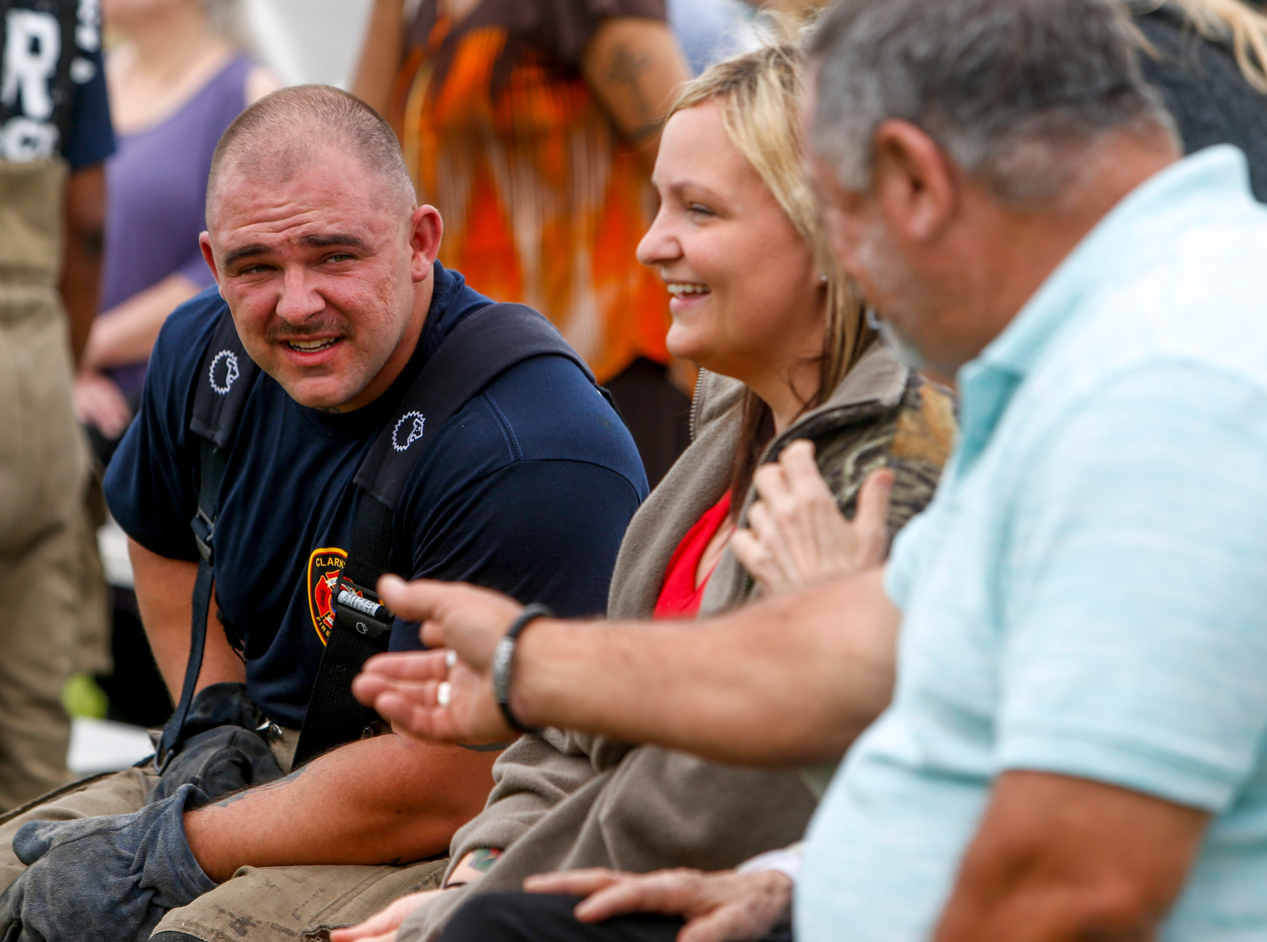 Cory Fain speaks with friends and family that came to watch him during his first live fire drill at Clarksville Fire Rescue in Clarksville, Tenn., on Friday, May 10, 2019.