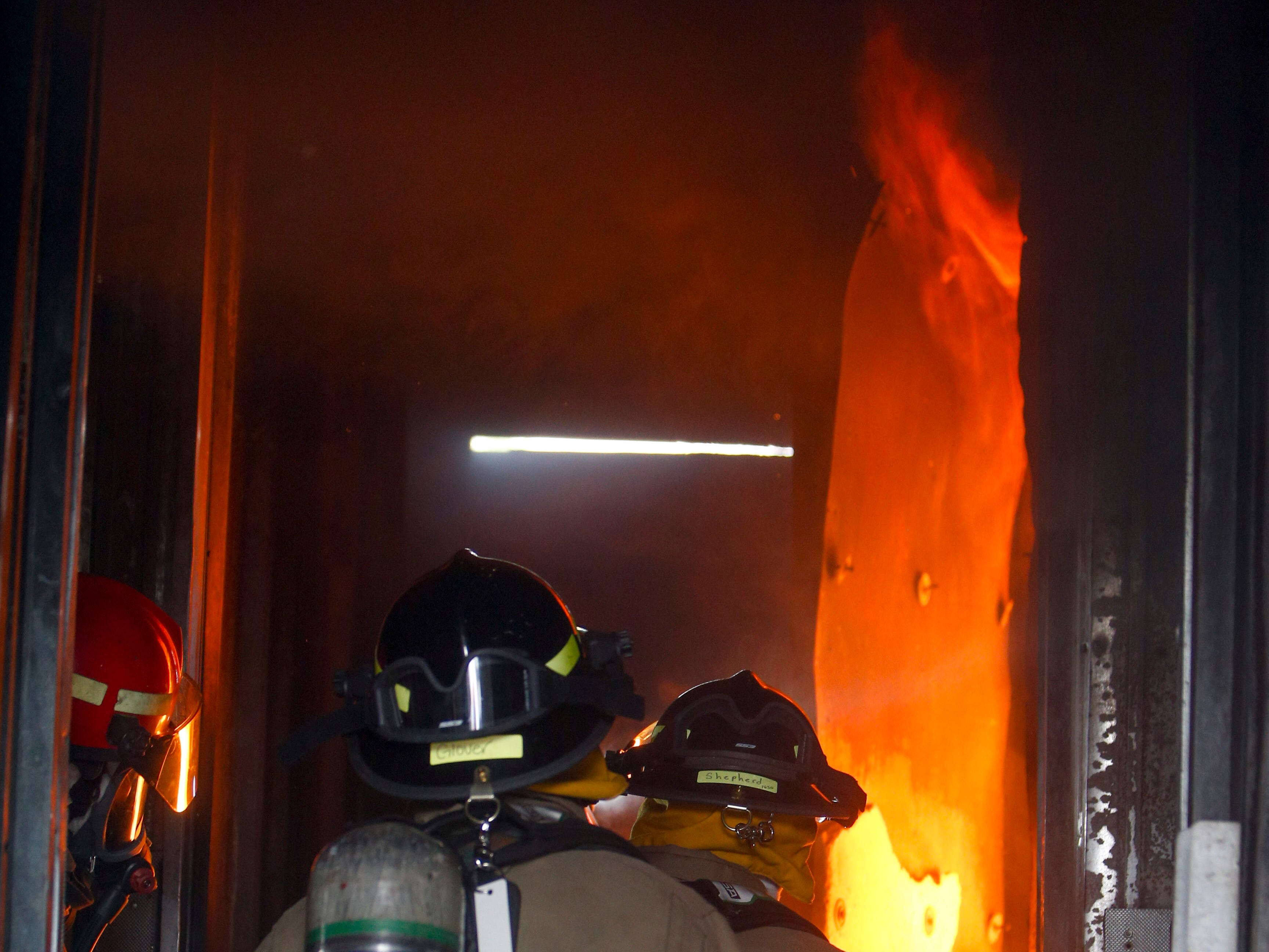 Flames emerge from the rooms during a live fire drill for new recruits at Clarksville Fire Rescue in Clarksville, Tenn., on Friday, May 10, 2019.