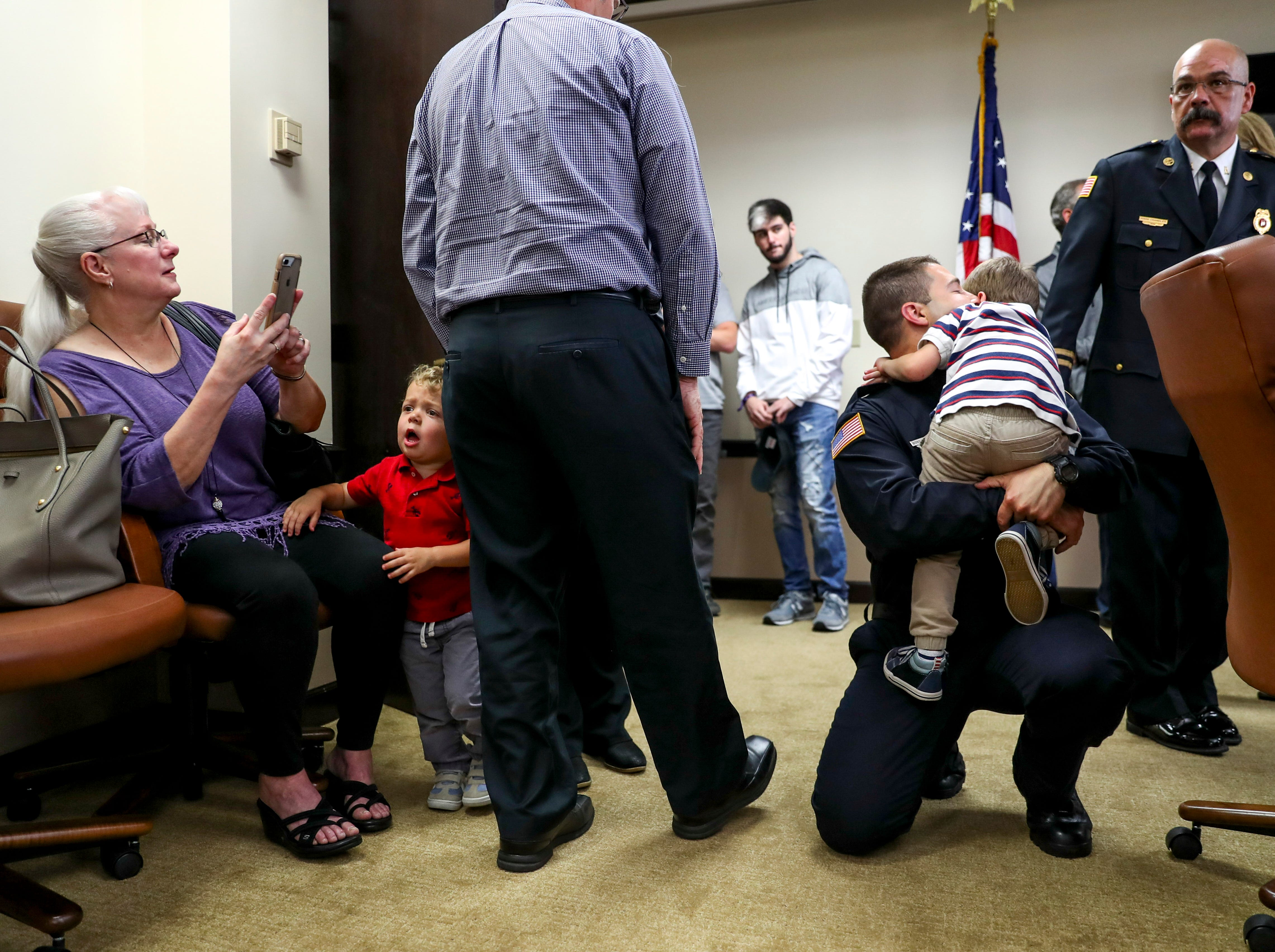 Bobby Melanson, right, hugs his son Caleb, 5, after being sworn in at Clarksville City Hall on Friday, May 10, 2019.