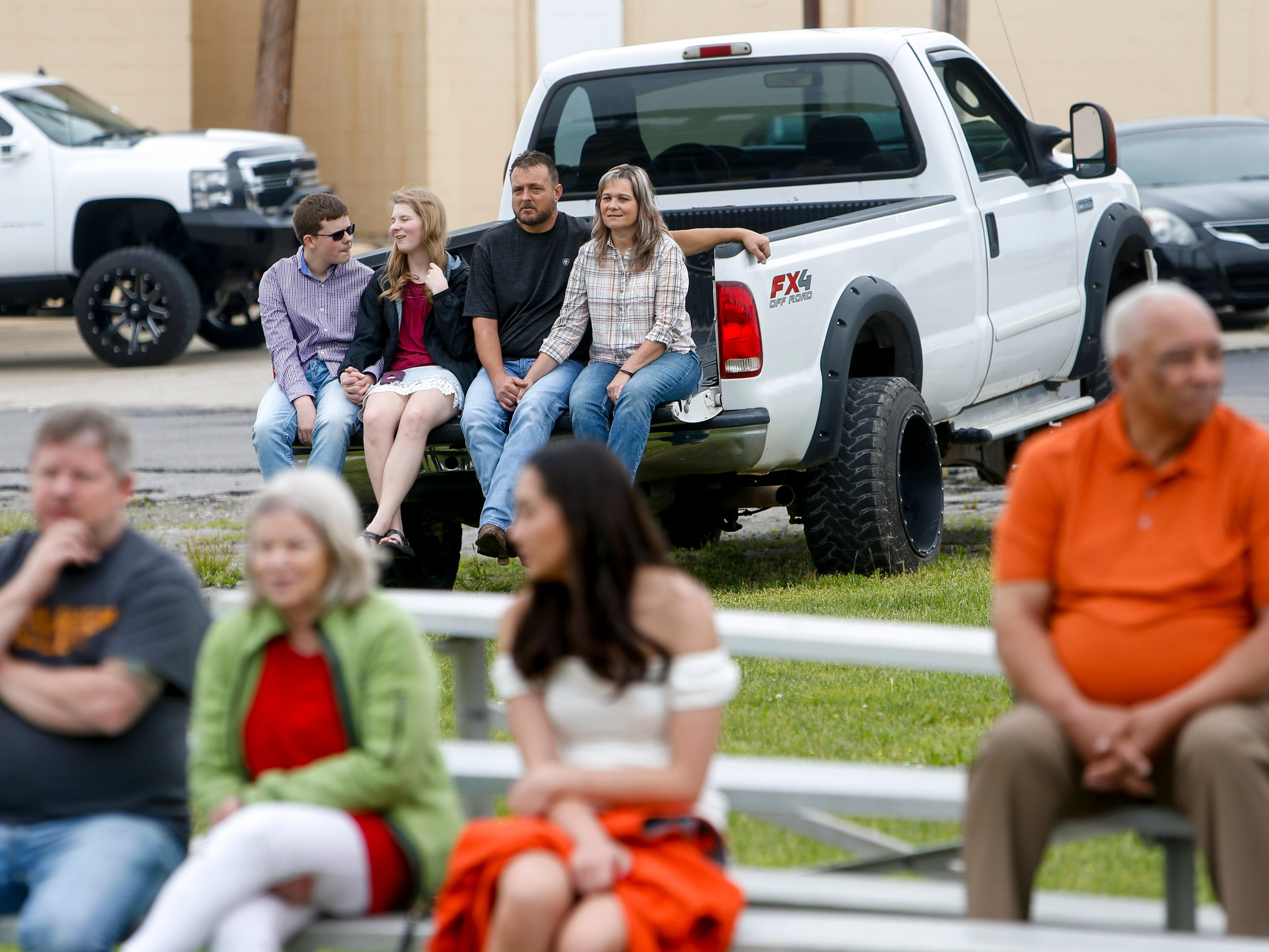 Family and friends sit on bleachers and in truck beds to watch new recruits in their first live fire drill at Clarksville Fire Rescue in Clarksville, Tenn., on Friday, May 10, 2019.