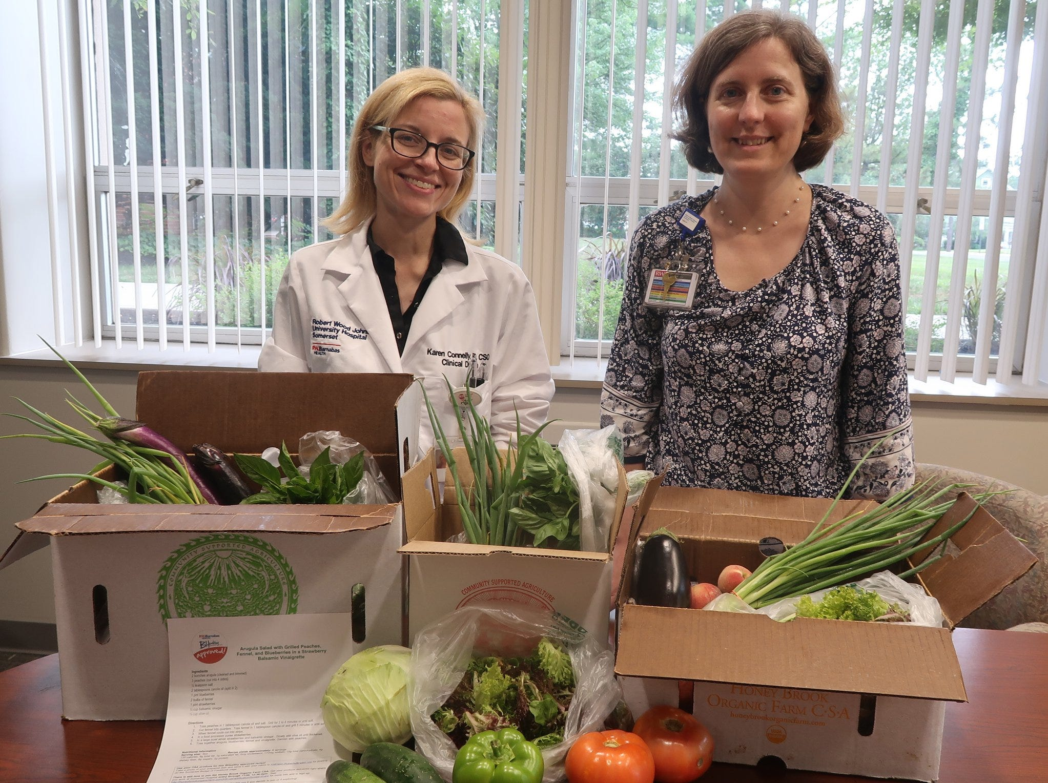 Robert Wood Johnson University Hospital employees with their farm shares from Honey Brook Organic Farm.