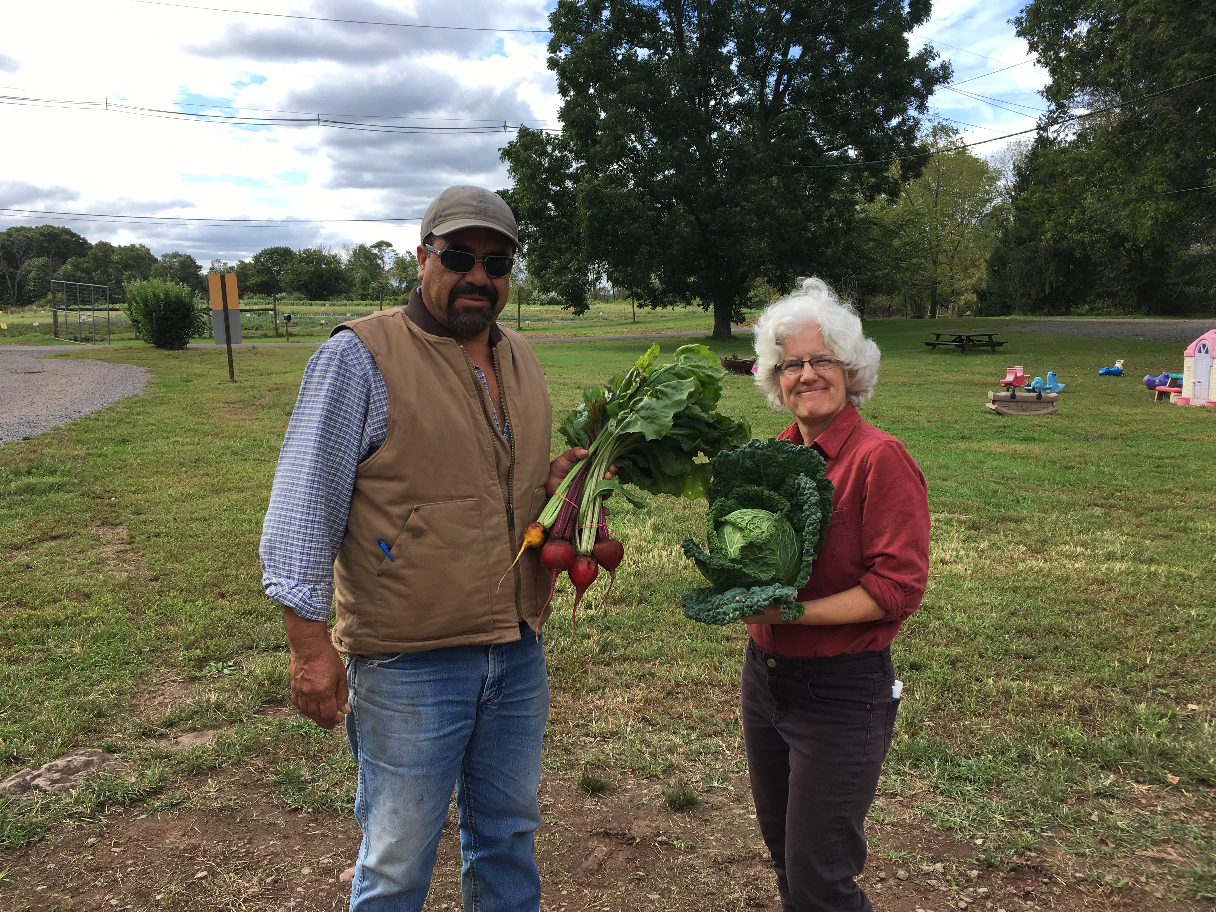 Field manager David Camacho and Farmer Sherry Dudas with fall produce at Honey Brook Organic Farm.