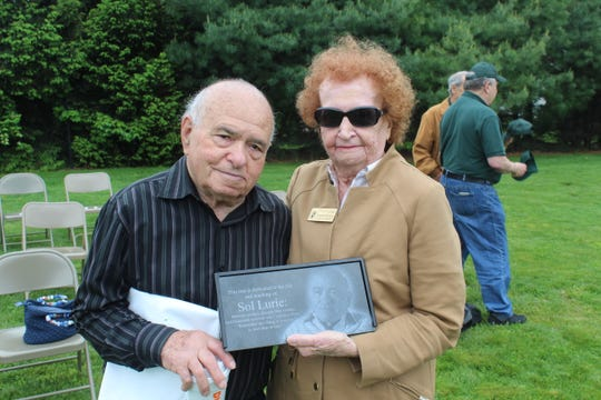 Honoree Sol Lurie and Town Council Vice-President Elizabeth Schneider hold the plaque that will sit at the base of the tree.