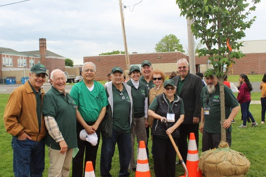 Monroe Township Mayor Charles DiPierro poses with members of the Township Shade Tree Commission before the planting.