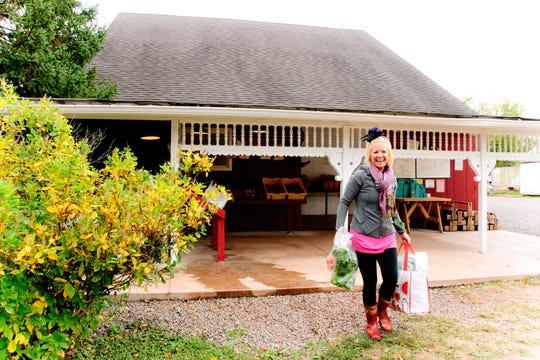 A happy customer at Honey Brook Organic Farm.