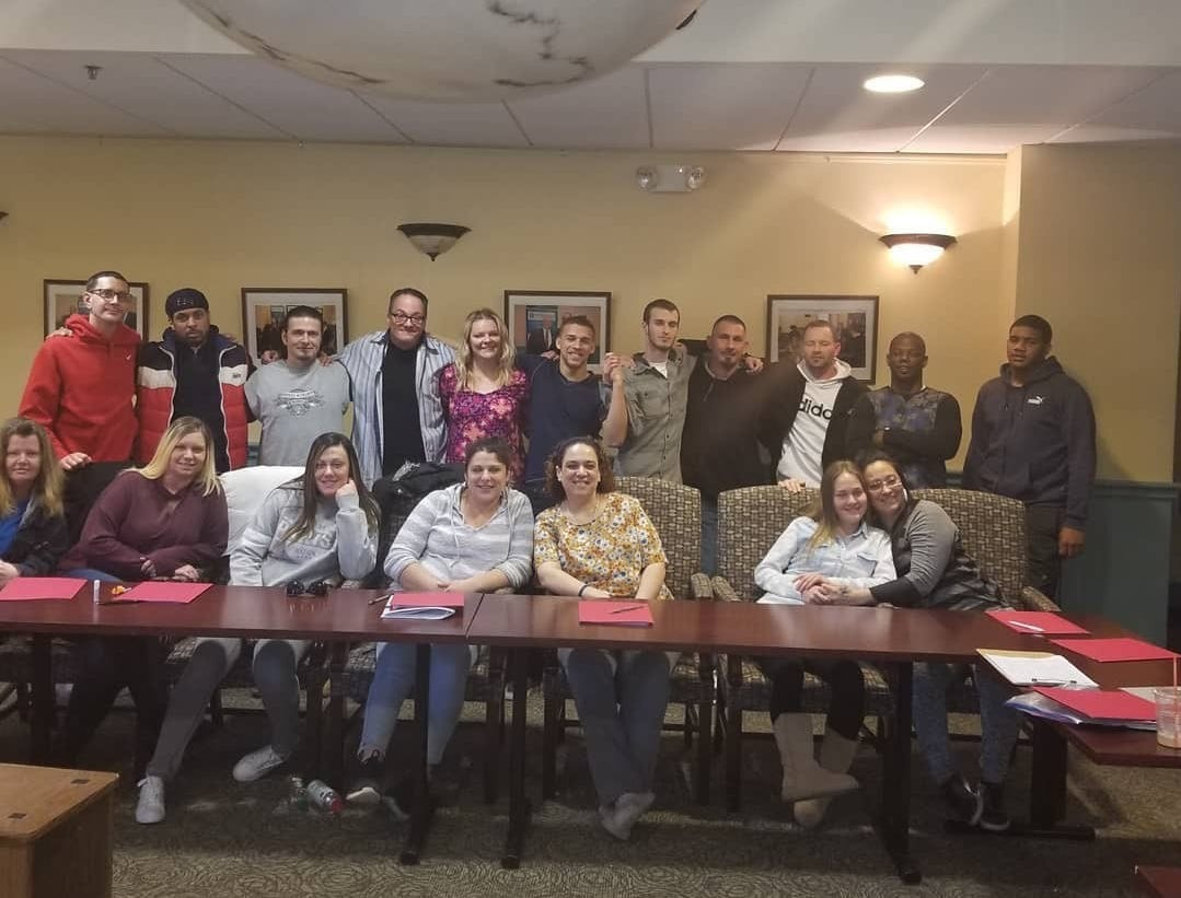 Having lived a life in addiction, Middlesex County's Cheyanne Curtin, 25, (center, back row) is now living a life in recovery and is a lead Empowerment Coach with the Linden-based Ammon Foundation.