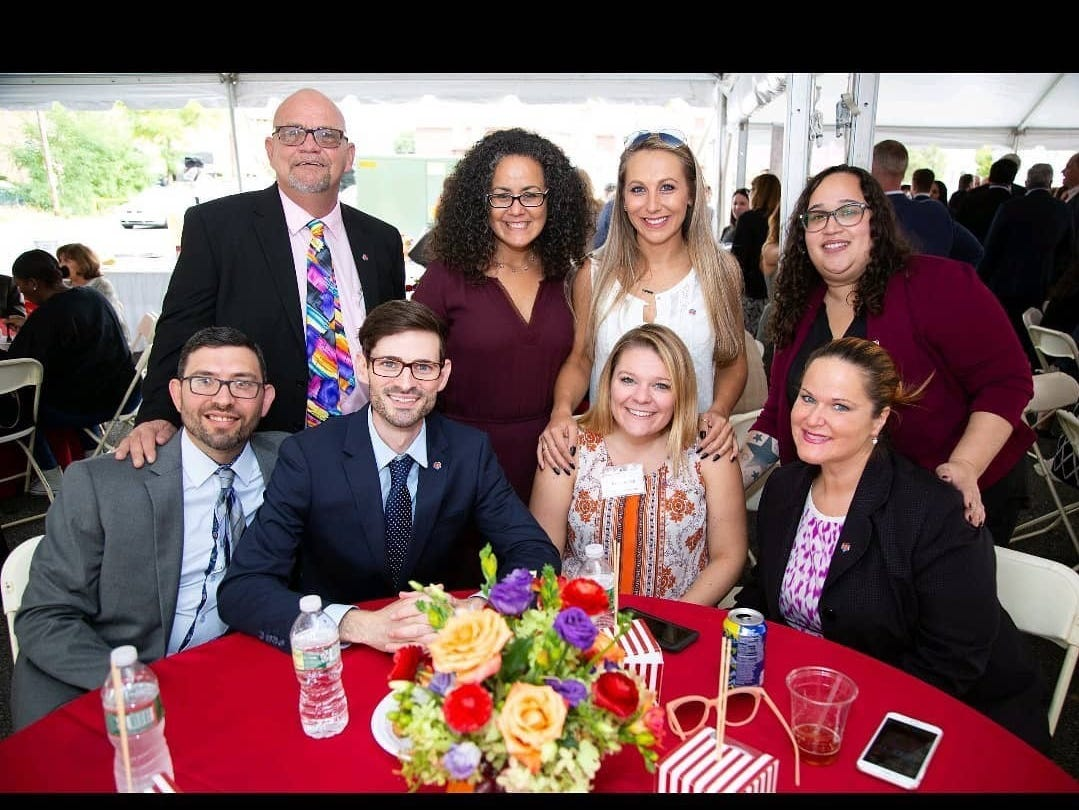 Having lived a life in addiction, Middlesex County's Cheyanne Curtin, 25, (center, bottom) is now living a life in recovery and is a lead Empowerment Coach with the Linden-based Ammon Foundation.