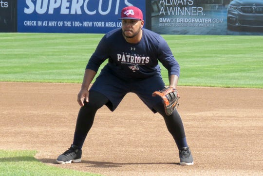 Edwin Espinal fields grounders during practice