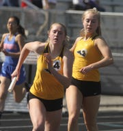 Southeast Polk sophomore Grace Larkins takes the baton from junior Natalie Clement for the anchor leg of the 800-meter sprint medley. Southeast Polk qualified for state with a seed mark of 1:49.49. The state qualifying meet was held at Johnston on May 10.