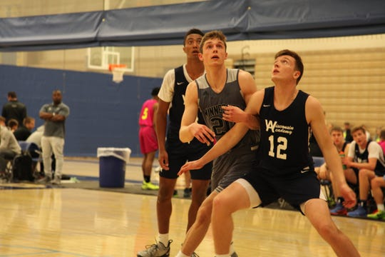 Class of 2020 prospect Ben Carlson (middle) fights for a rebound during Battle at the Lakes.