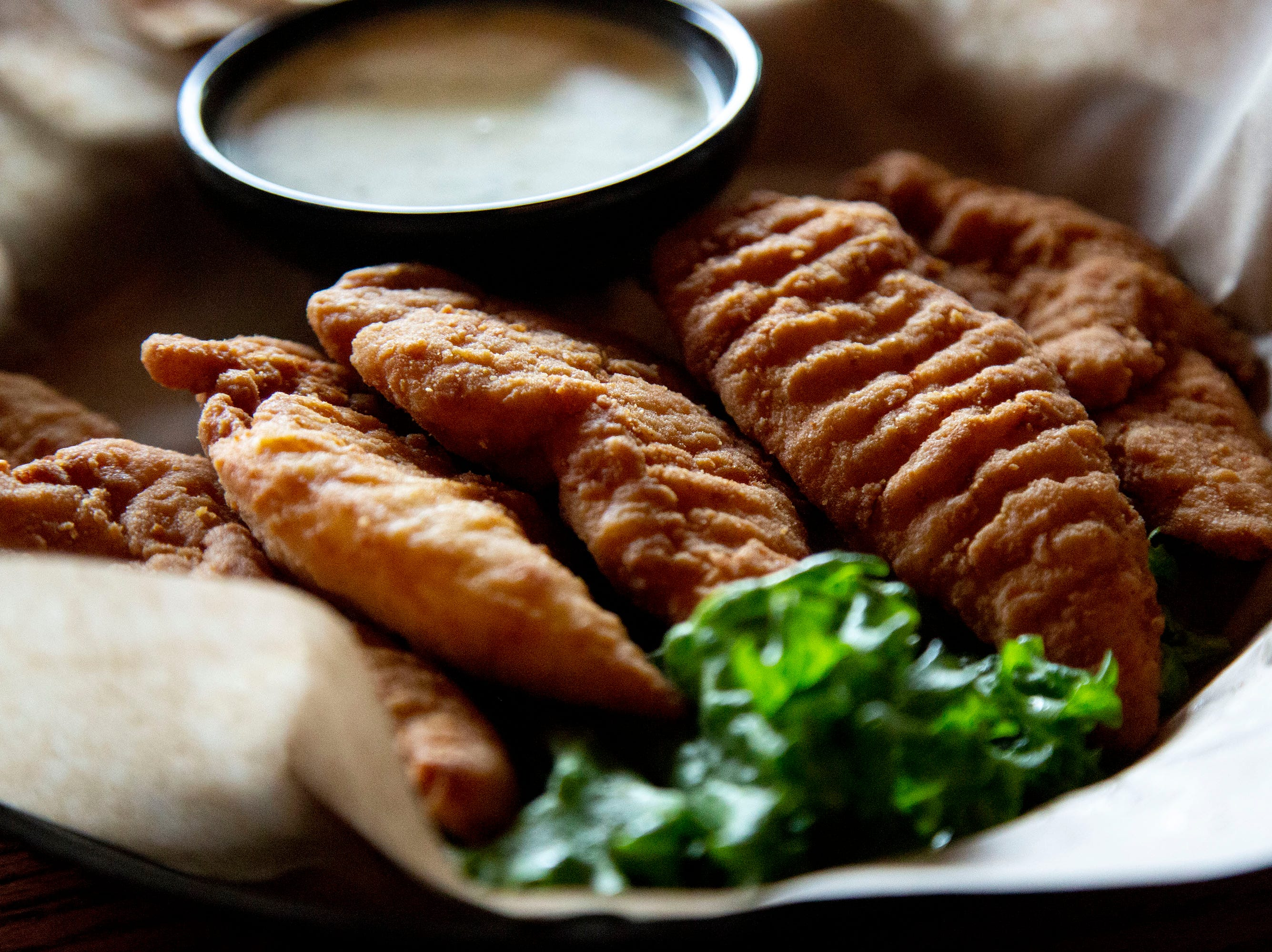 Chicken tender strips served with homemade honey mustard dressing from Francie's Bar and Grill, on Wednesday, April 10, 2019, in Des Moines.