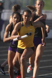 Southeast Polk sophomore Magda McGowan runs the second leg of the 4x800-meter relay. The Rams qualified for state with a seed mark of 9:37.91. The state qualifying meet was held at Johnston on May 10.