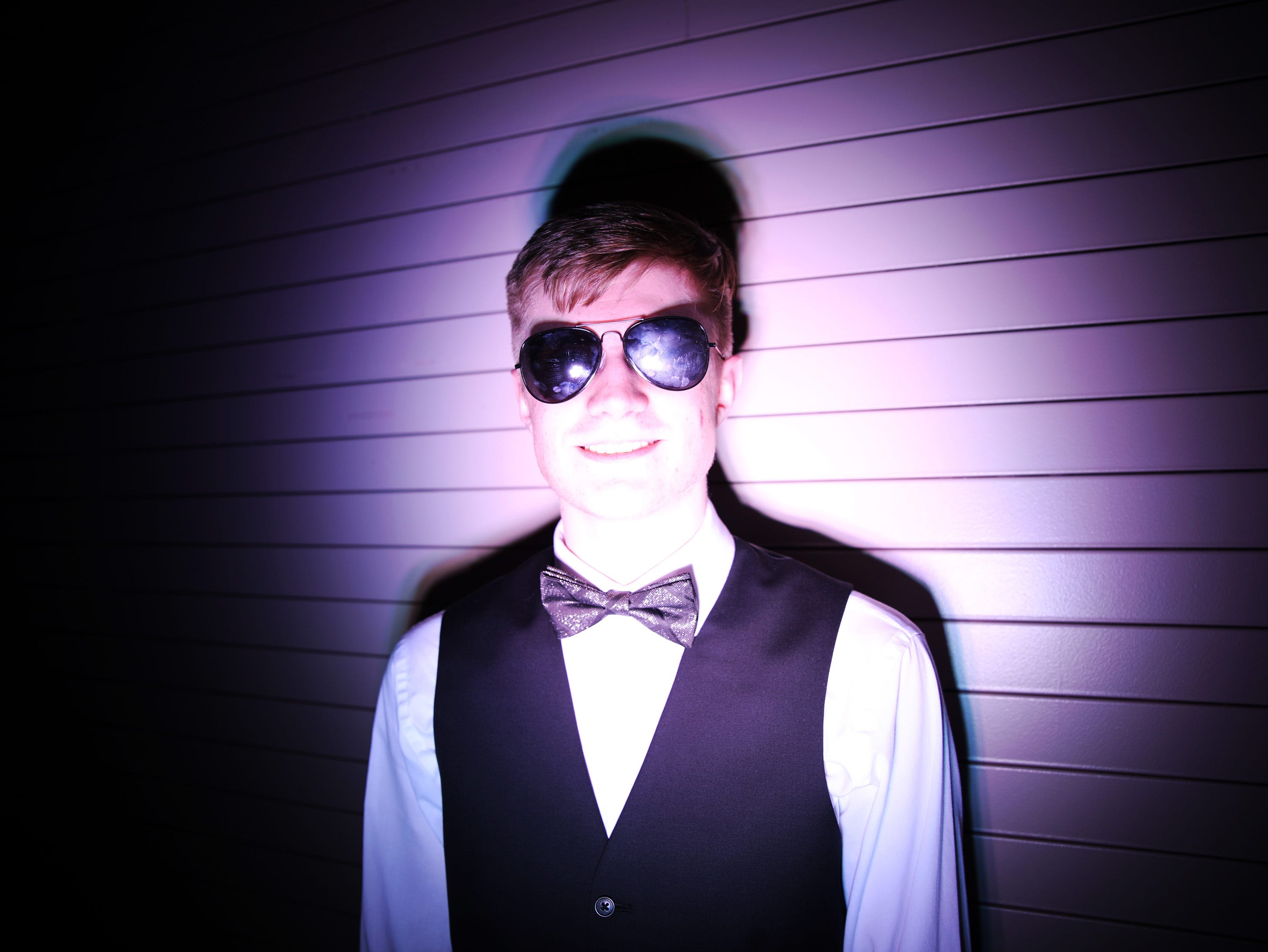 The spotlight is on junior Joshua Carlberg at the circus-themed Urbandale High School Junior/Senior Prom Spectacular at the State Historical Building in Des Moines on Saturday, April 11, 2019.  The post-prom event is held at school right after the dance from 11 p.m. to 4:30 a.m. with food, prizes, a hypnotist, inflatables, and casino games.