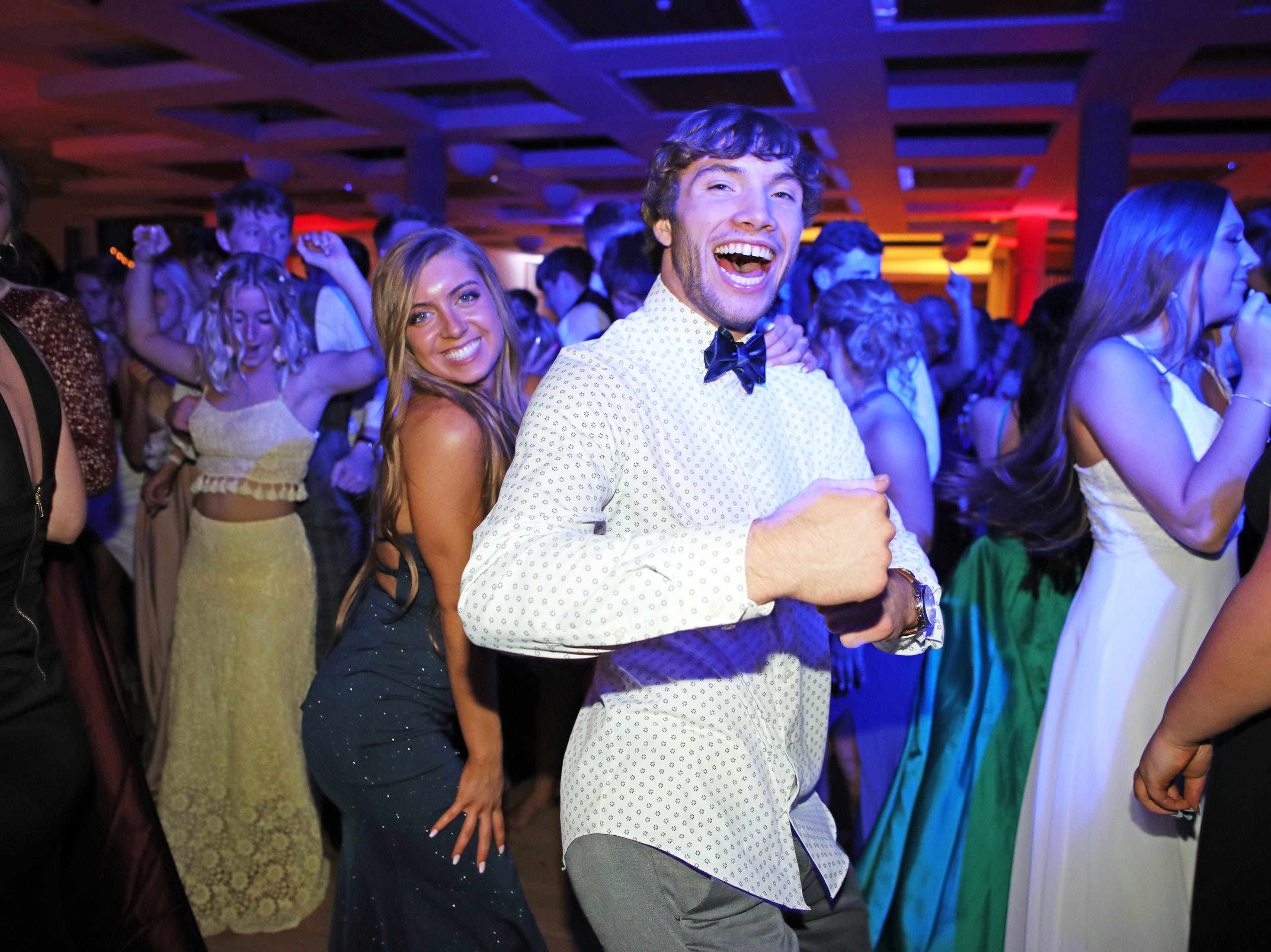 Seniors Hayden Friedrichsen and Emily Cormier dance the night away during the circus-themed Urbandale High School Junior/Senior Prom Spectacular at the State Historical Building in Des Moines on Saturday, April 11, 2019.  The post-prom event is held at school right after the dance from 11 p.m. to 4:30 a.m. with food, prizes, a hypnotist, inflatables, and casino games.