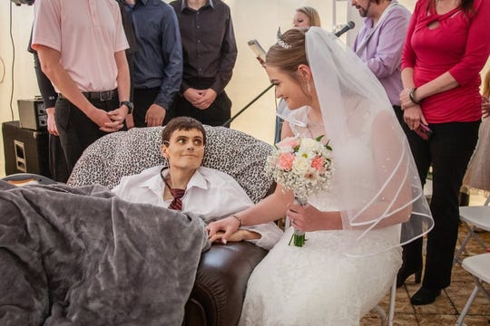 Tristin Laue died at age 20 from complications of a rare liver cancer called fibrolamellar, just hours after marrying Tianna Hargrafen on April 27 in Waverly, Iowa.