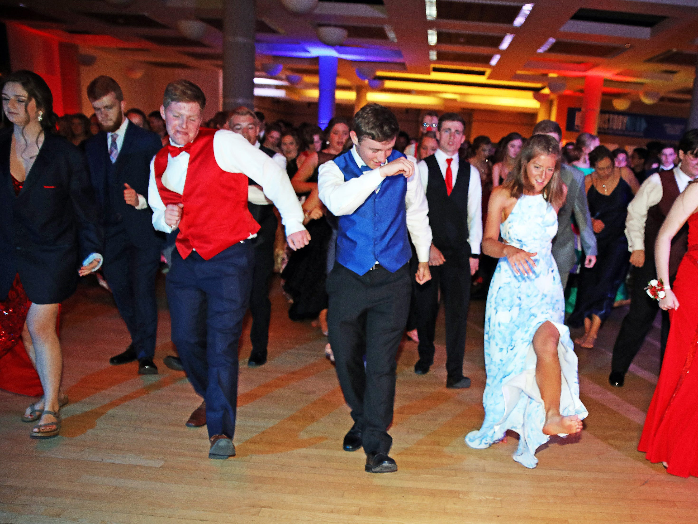 J-Hawk students hit the dance floor as the Cupid Shuffle plays during the circus-themed Urbandale High School Junior/Senior Prom Spectacular at the State Historical Building in Des Moines on Saturday, April 11, 2019.  The post-prom event is held at school right after the dance from 11 p.m. to 4:30 a.m. with food, prizes, a hypnotist, inflatables, and casino games.