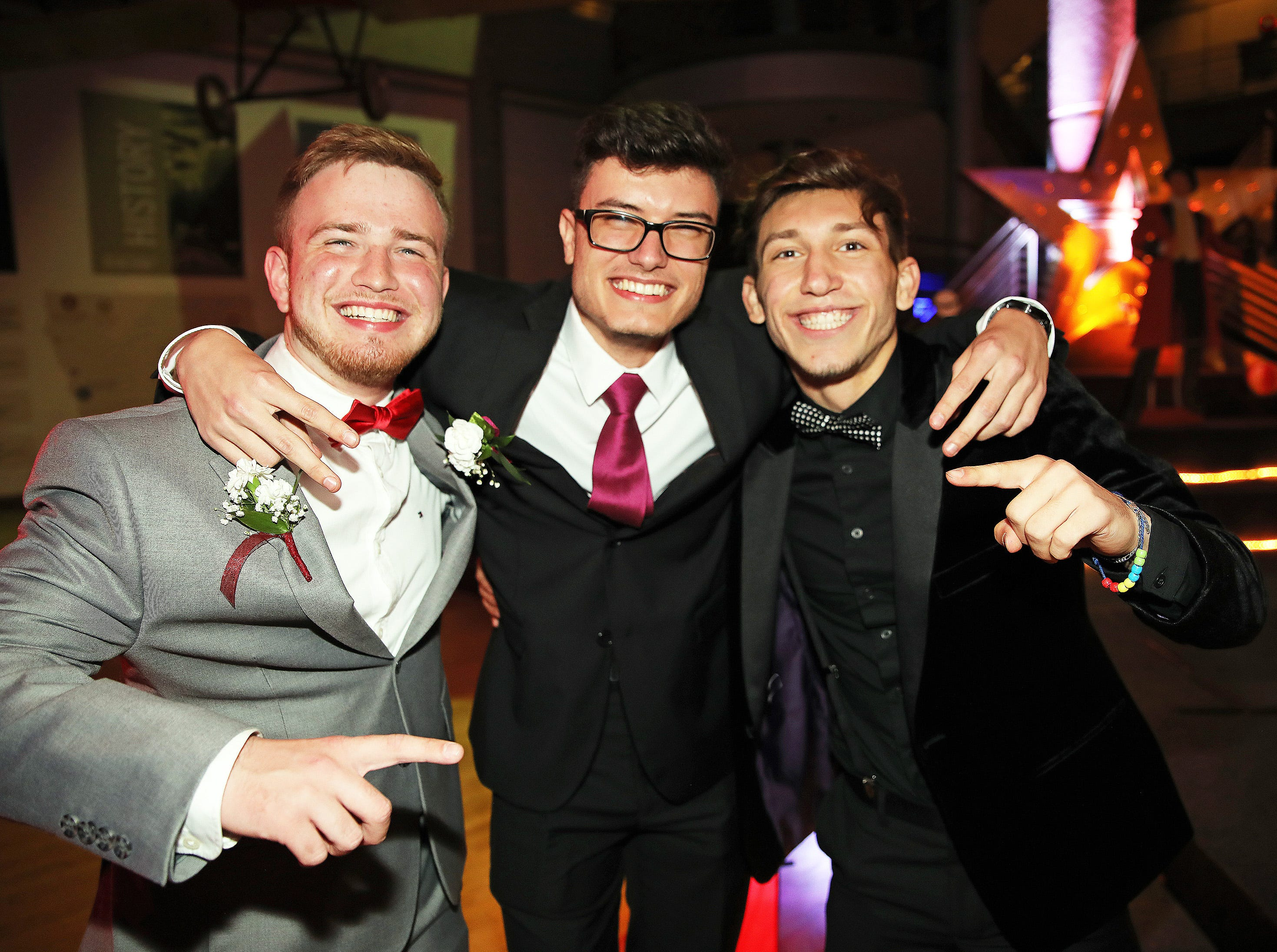 (left to right) Seniors Armin Hasancevic, Semir Omerovic, Alan Imamovic attend the circus-themed Urbandale High School Junior/Senior Prom Spectacular at the State Historical Building in Des Moines on Saturday, April 11, 2019. The post-prom event is held at school right after the dance from 11 p.m. to 4:30 a.m. with food, prizes, a hypnotist, inflatables, and casino games.