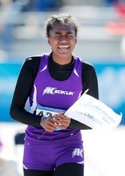 Keokuk's Miracle Ailes reacts after winning the girls high school high jump at the Drake Relays.