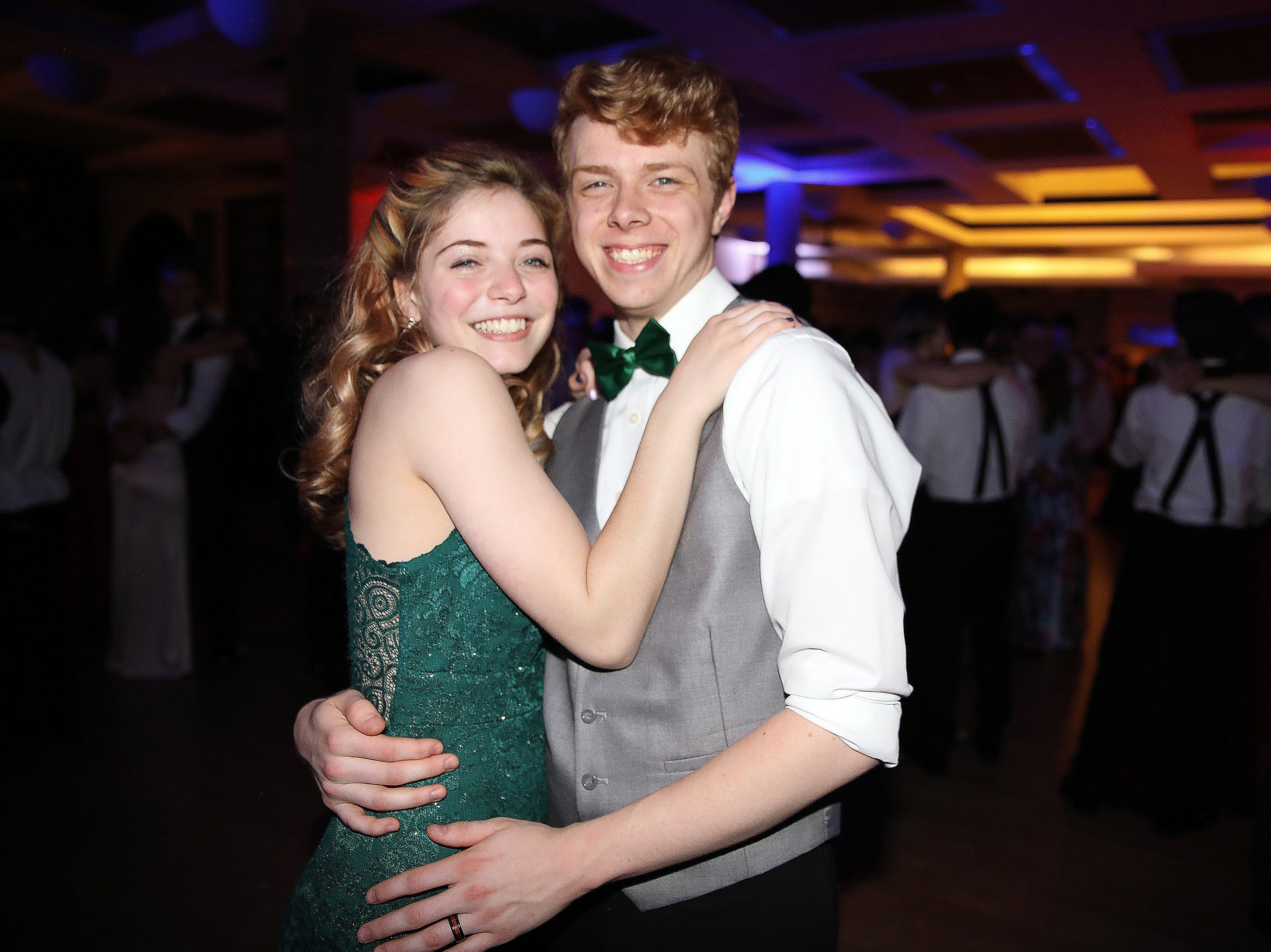 Junior Mahayla Claiser and graduate Andrew Van Zante enjoy a slow dance during the circus-themed Urbandale High School Junior/Senior Prom Spectacular at the State Historical Building in Des Moines on Saturday, April 11, 2019.  The post-prom event is held at school right after the dance from 11 p.m. to 4:30 a.m. with food, prizes, a hypnotist, inflatables, and casino games.