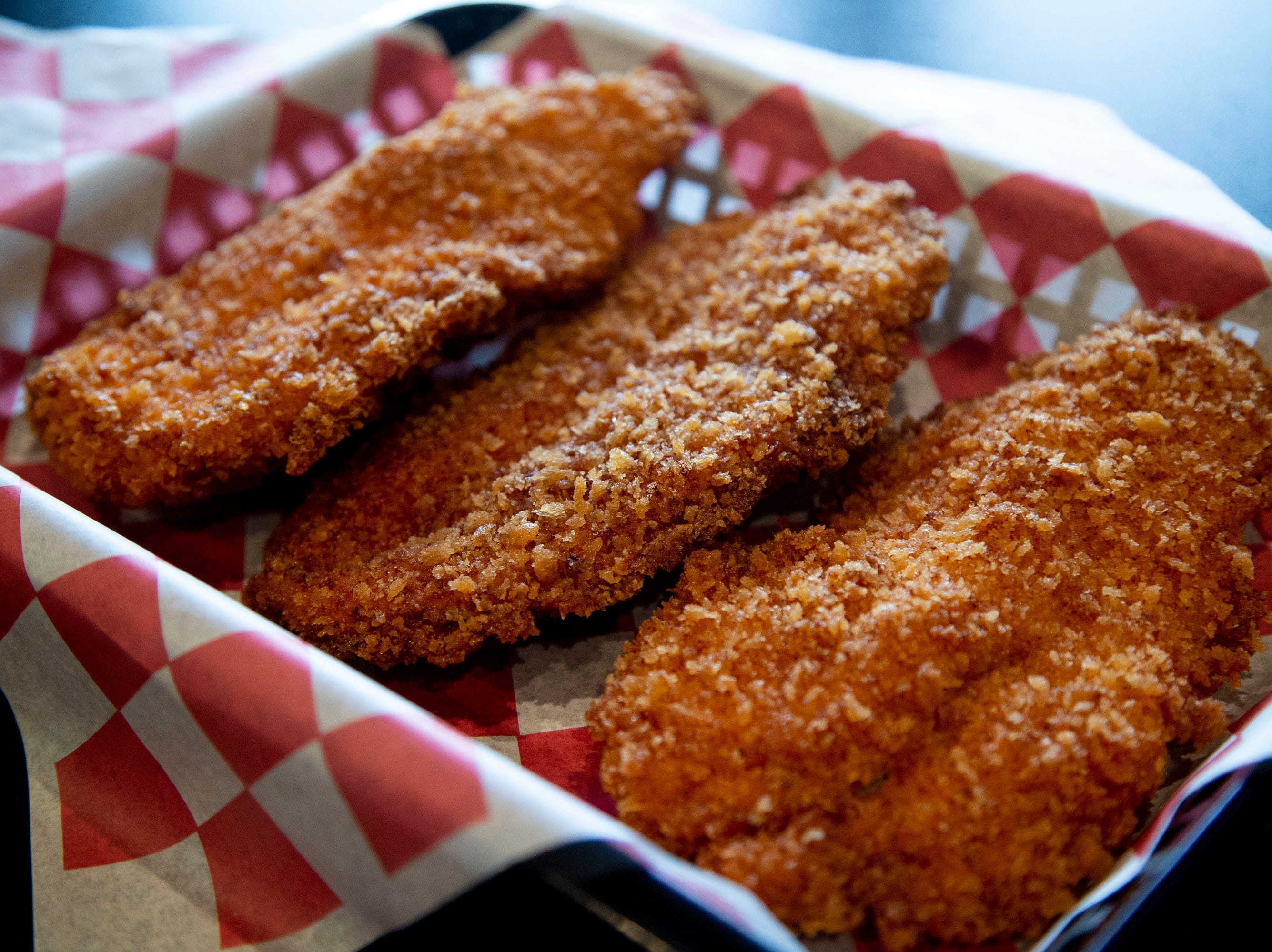Rolling Smoke Barbeque's chicken strip platter with hand-breaded chicken tenders on Wednesday, April 10, 2019, in Pleasant Hill.