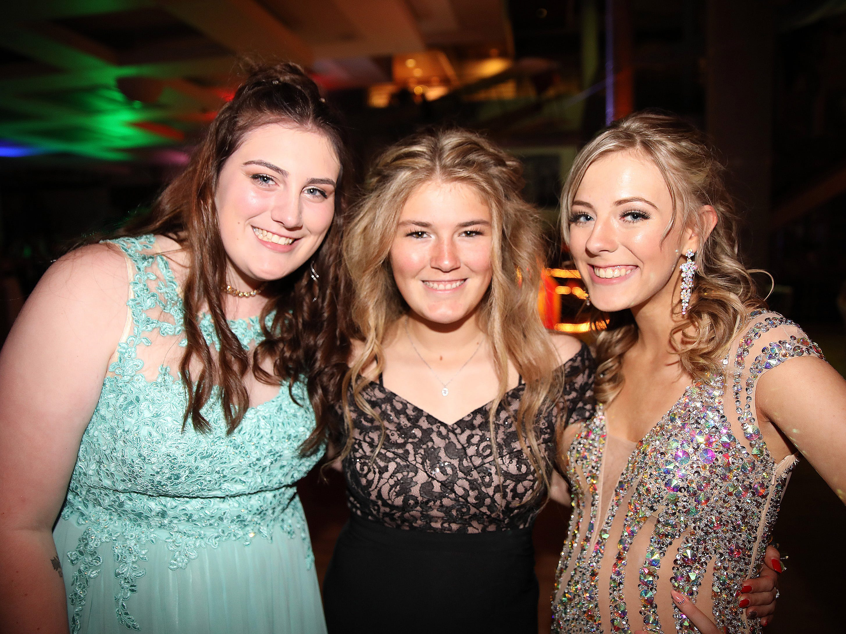 (left to right) Seniors Samantha Miller, Claire Crees, and Macayla Rhodes attend the circus-themed Urbandale High School Junior/Senior Prom Spectacular at the State Historical Building in Des Moines on Saturday, April 11, 2019.  The post-prom event is held at school right after the dance from 11 p.m. to 4:30 a.m. with food, prizes, a hypnotist, inflatables, and casino games.