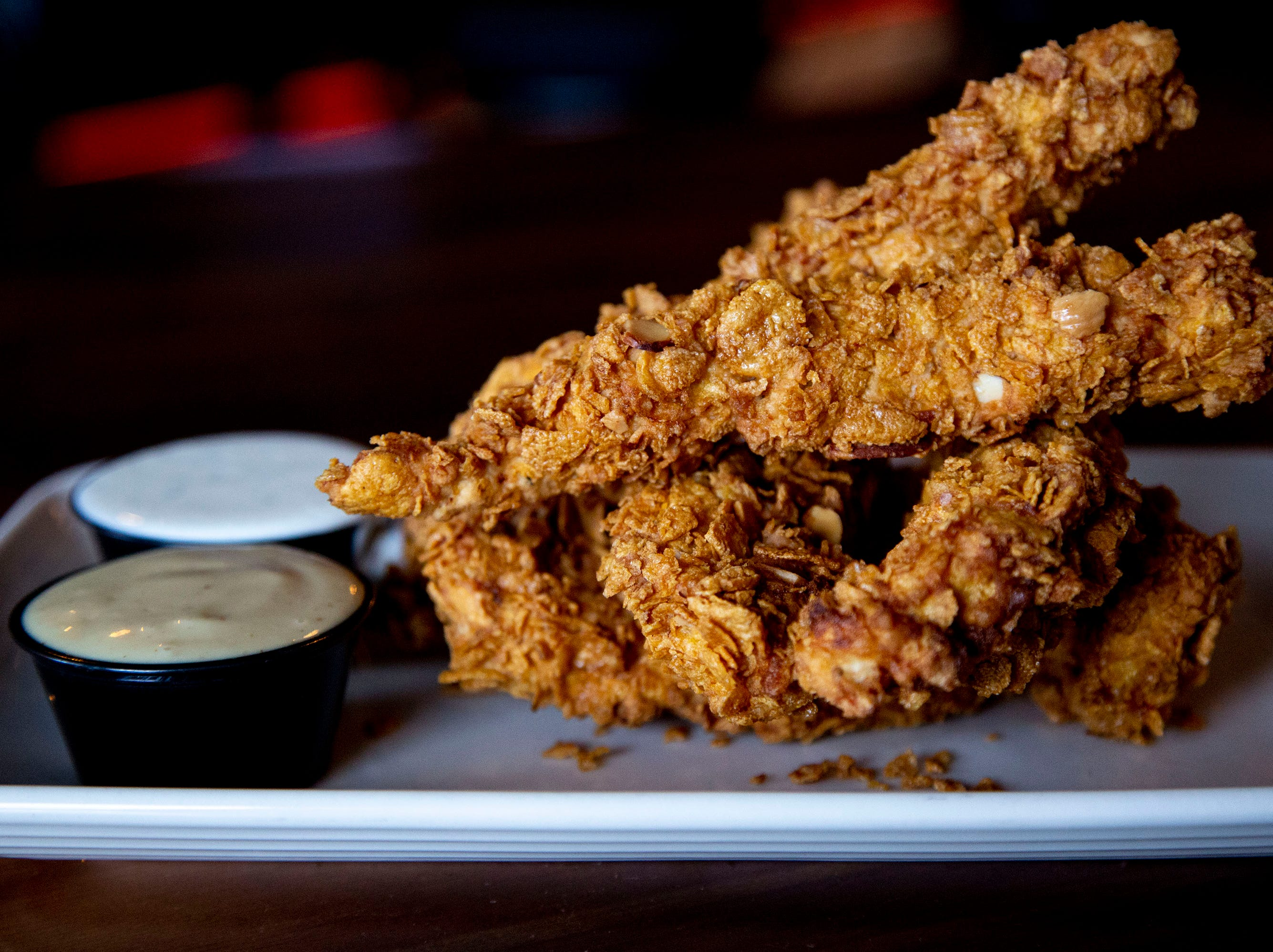 The almond encrusted chicken tenders at the Grumpy Goat Tavern on Wednesday, April 10, 2019, in West Des Moines.