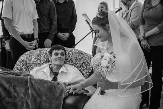Tristin Laue smiles at his April 27 wedding to Tianna Hargrafen. Laue died at age 20 from complications of a rare liver cancer called fibrolamellar, just hours after the Waverly, Iowa ceremony.