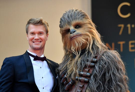 "Finnish actor Joonas Suotamo (L) who plays Chewbacca poses with Chewbacca as they arrive on May 15, 2018 for the screening of the film ""Solo : A Star Wars Story"" at the 71st edition of the Cannes Film Festival in Cannes, southern France."
