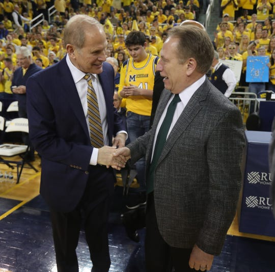 John Beilein and Tom Izzo chat before the game Feb. 24, 2019 at the Crisler Center.