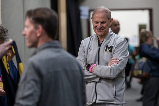 Michigan basketball head coach John Beilein smiles as he walks out of the locker room before press conference at the Honda Center in Anaheim, Calif., Wednesday, March 27, 2019.