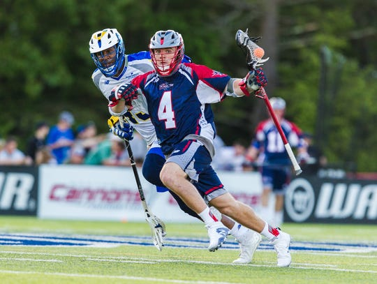 Tom Kennedy carries the ball for the Boston Cannons of Major League Lacrosse.