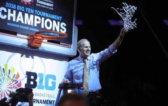 Michigan head coach John Beilein celebrates winning the Big Ten Tournament Championship 75-66 over Purdue Sunday, March 4, 2018 at Madison Square Garden in New York. Kirthmon F. Dozier/Detroit Free Press