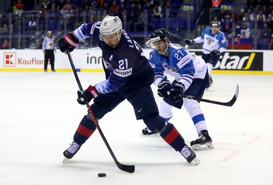 Red Wings forward Dylan Larkin of United States challenges Eetu Luostarinen of Finland during the 2019 World Championship on May 13, 2019, in Kosice, Slovakia.