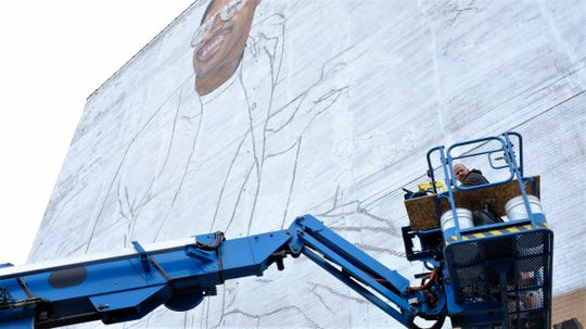 London-based artist Richard Wilson was finishing details of Stevie Wonder's face on a new mural being installed on the wall of the Music Hall Center for the Performing Arts on May 13, 2019.