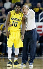 462109152.jpg ANN ARBOR, MI - JANUARY 24:  Head coach John Beilein of the Michigan Wolverines gives directions to Derrick Walton Jr. #10  during overtime of a Big Ten game against the Wisconsin Badgers at Crisler Arena on January 24, 2015 in Ann Arbor, Michigan. Wisconsin defeated Michigan 69-64.