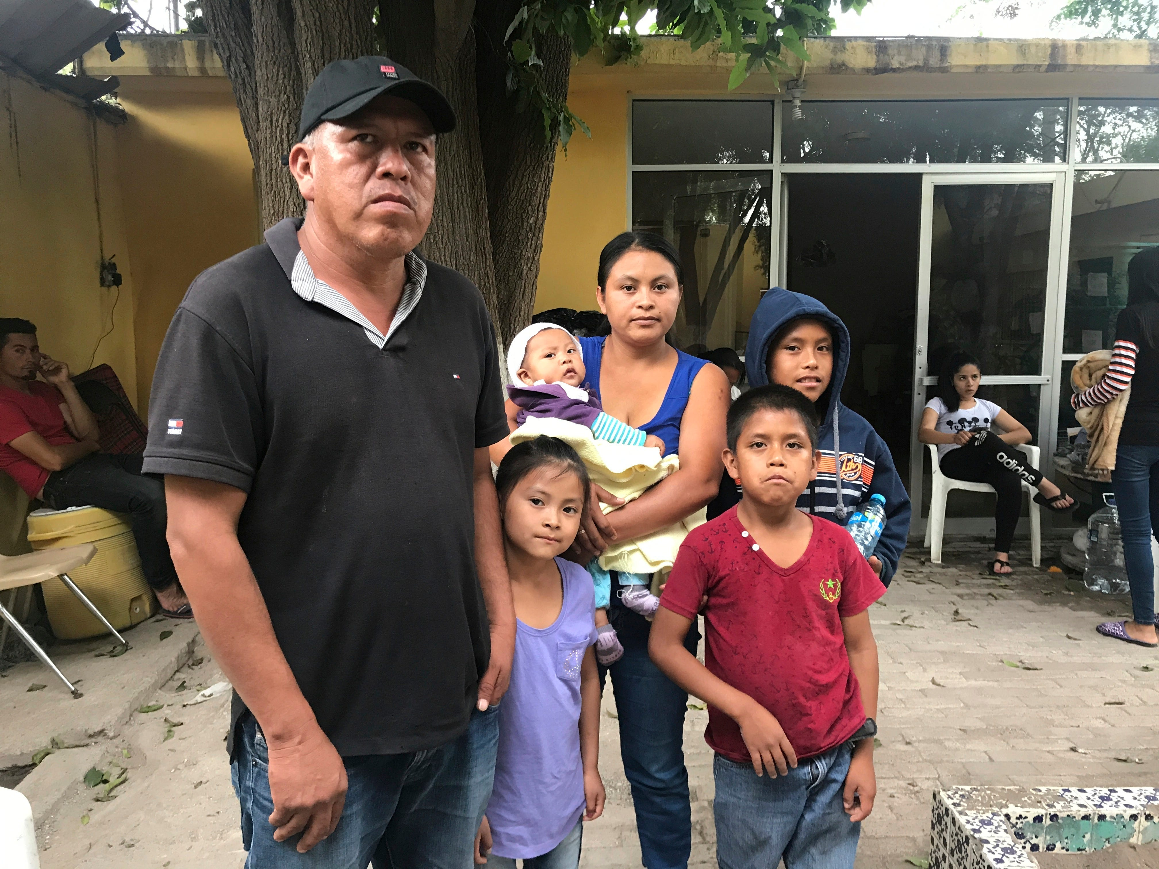 Bernardino Blanco Romero, from Guerrero, Mexico, stands with his wife, Consuelo Salgado Cruz, and four children at a shelter in Piedras Negras, Mexico, as they seek asylum in the U.S. Blanco said he chose to go to Piedras Negras because it is not violent.