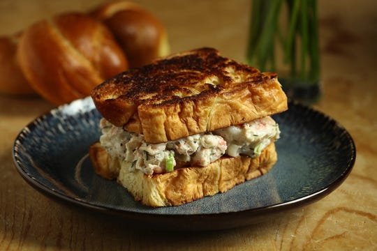Creamy seafood rolls on buttered brioche can be served as sandwiches or cut into small wedges to be served as appetizers. (E. Jason Wambsgans/Chicago Tribune/TNS)