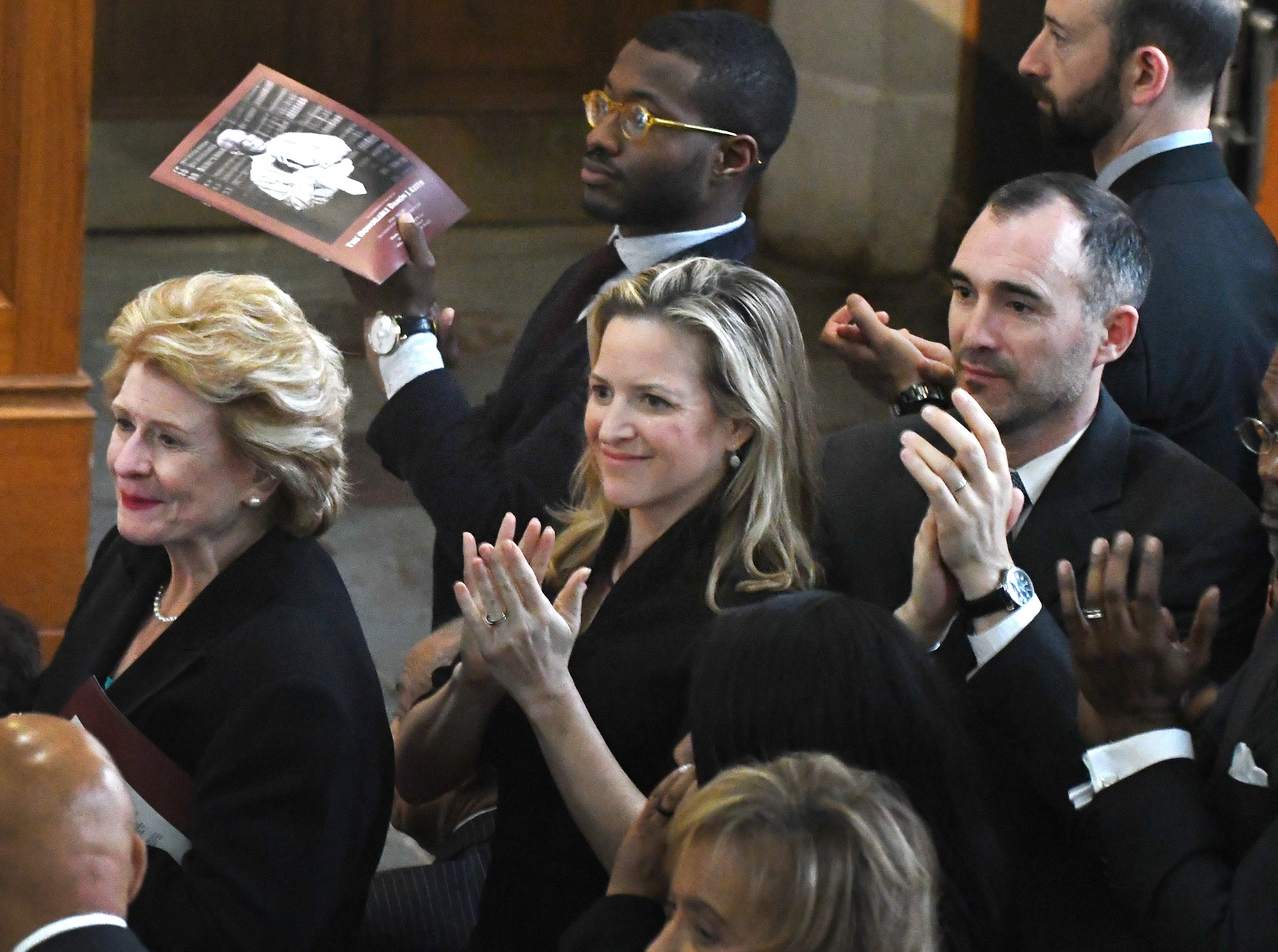 Senator Debbie Stabenow, Michigan Secretary of State Jocelyn Benson with husband Ryan Friedrichs during the funeral of Judge Damon J. Keith.