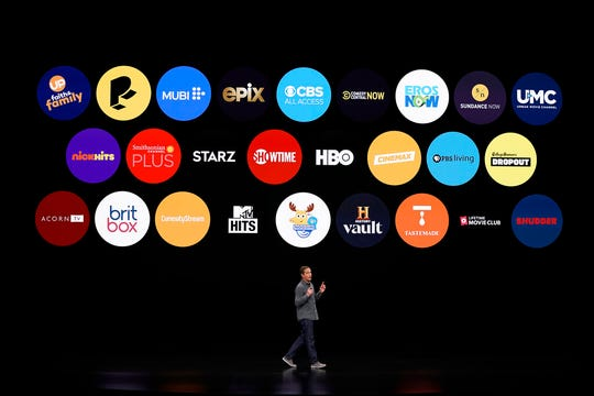 In this March 25, 2019, file photo Peter Stern, Apple Vice President of Services, speaks at the Steve Jobs Theater during an event to announce new products in Cupertino, Calif. Apple users will be able to subscribe to HBO, Showtime and a handful of other channels directly through Apple's new TV app, bypassing the need to download or launch a separate app.