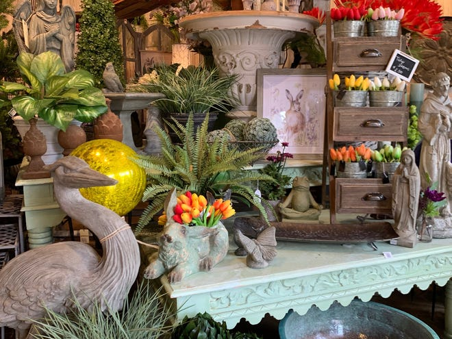 Awaken your outdoor space with decorative figures like statuary that complement your flowers and plants.