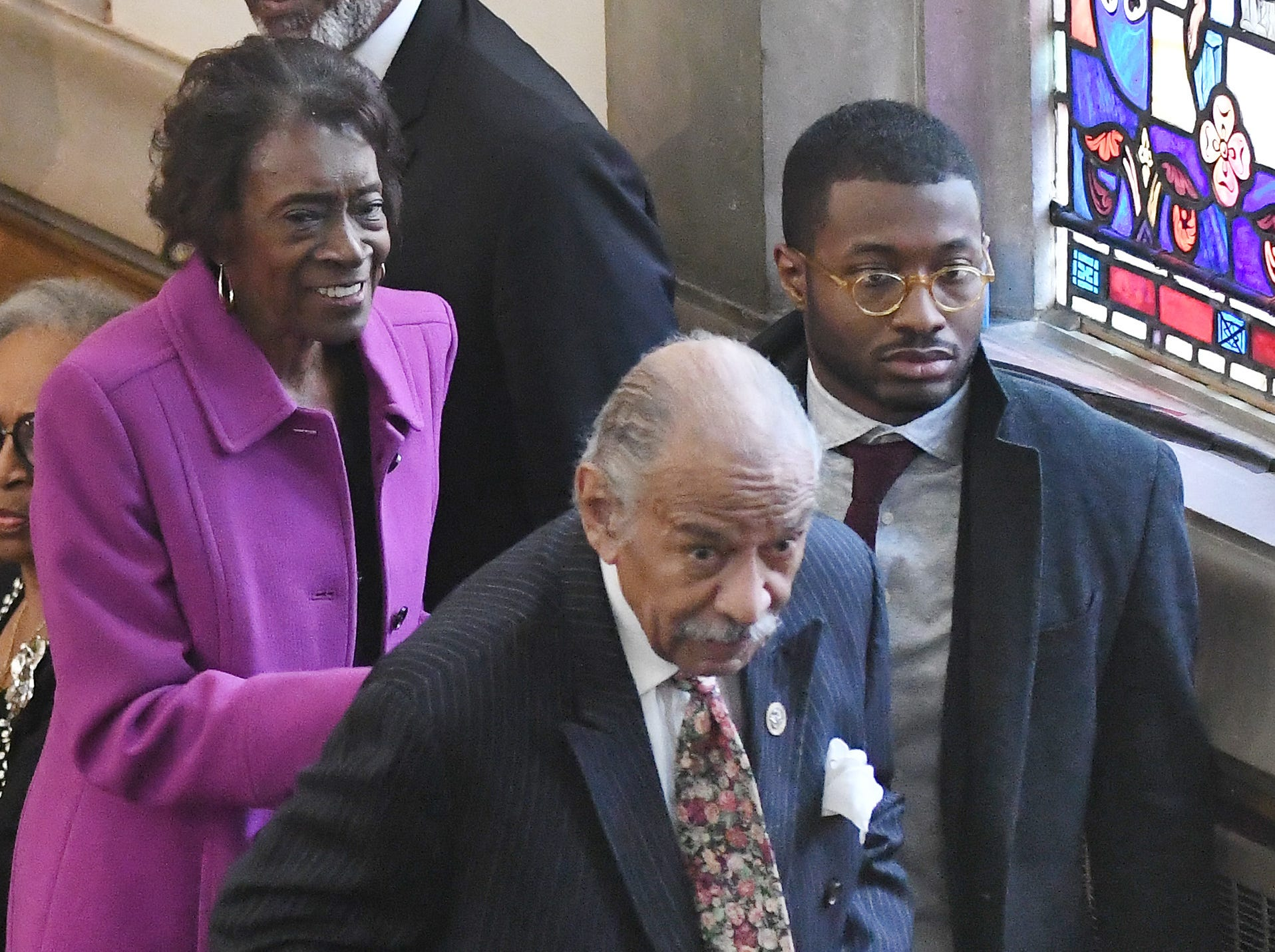 Former U.S. Representative John Conyers leaves the church after the funeral of Judge Damon Keith.