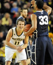 """""""The guy took a chance on me,"""" said Andrew Dakich, who played three seasons at Michigan (2013-16) after making the team as a walk-on."""