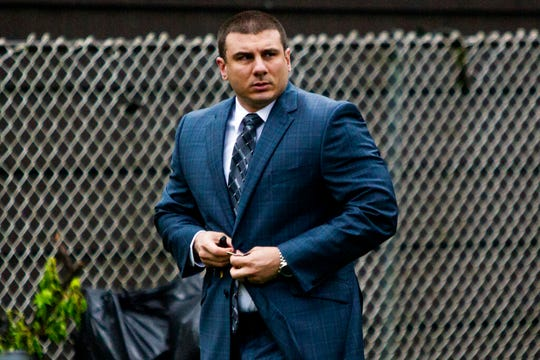 New York City police officer Daniel Pantaleo leaves his house Monday, May 13, 2019, in Staten Island, N.Y. A long-delayed disciplinary trial is set to begin Monday for Pantaleo, accused of using a banned chokehold in the July 2014 death of Eric Garner.