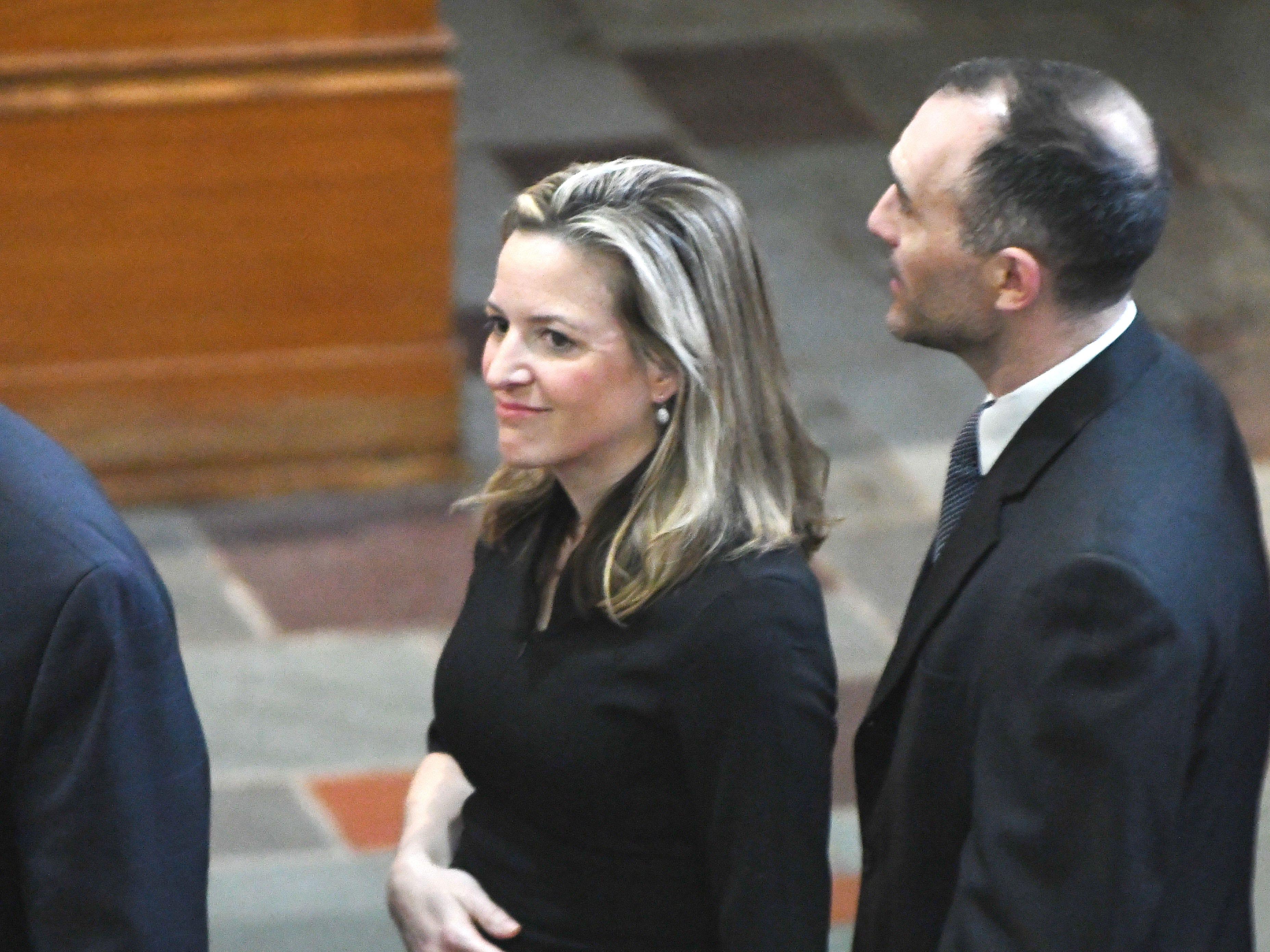 Michigan Secretary of State Jocelyn Benson with husband Ryan Friedrichs during the funeral of Judge Damon J. Keith.