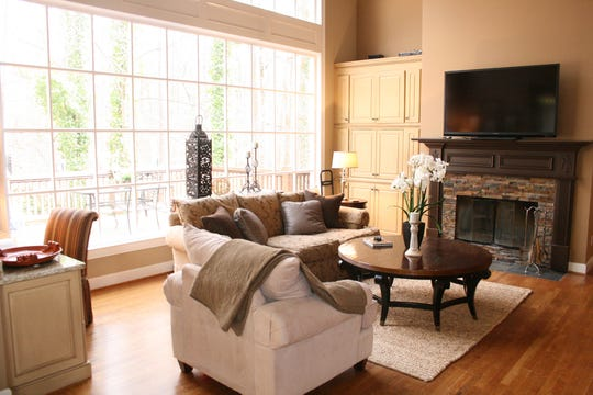 Before: A family room's furniture arrangement is disjointed.
