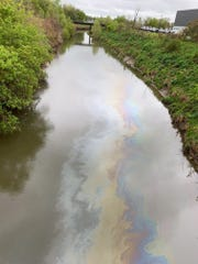 Macomb County Public Works Commissioner Candice Miller said her office has deployed a boom to absorb petroleum causing a sheen on the Red Run Drain in Warren.